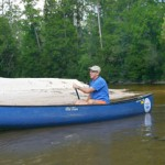 Jack Sanborn, Owner and Operator of Adventures Unlimited, canoeing down the Coldwater Creek