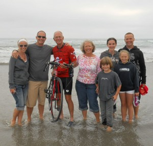 """This was a photo taken from his blog...""""Today we finished packing and said goodbye to some of our family. Jon, Marcie, Kol, Agi, Maya and Christian joined us for a pasta (carbo loading) dinner.  We went to the beach by our condo in Oceanside, CA and dipped the rear wheel in the Pacific, next time the Atlantic."""" title="""